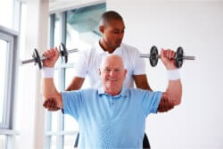 elderly having physical therapy